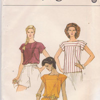 1980s vintage pattern for loose fitting, short sleeved, pullover top with decorative yoke misses size 12 Vogue 8307 UNCUT