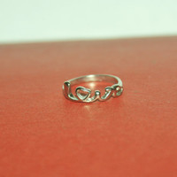 Silver Love ring, Size 5, Get this free with a 30 dollar purchase