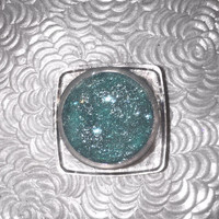 Shade name ( High Tide ). Vibrant teal blue  loose glitter pigment. 4 grams of product in a jar with sifter and seal. Vegan and cruelty free