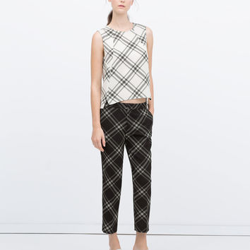 SKINNY TROUSERS WITH LARGE CHECK PRINT