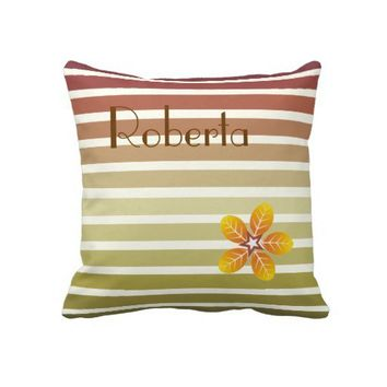 Striped fall pattern and flower in autumn colors throw pillows from Zazzle.com