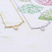 Tiny peace sign with wings necklace in  silver or gold tone