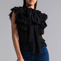 AKIRA Pussybow Ruffled Sleeveless Sheer Blouse in Black