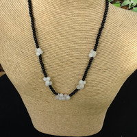 Black agate necklace with rose quartz bone shaped beads