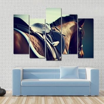Saddle With Stirrups On A Back Of A Horse Multi Panel Canvas Wall Art