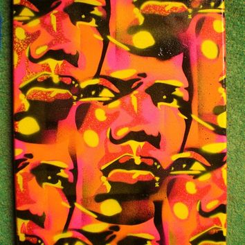 Mans face painting,stencil art,spray paint,pop art,street art,abstract,urban,tribal,wall art,Europe,yellow,pink,orange,graffiti,African,eyes
