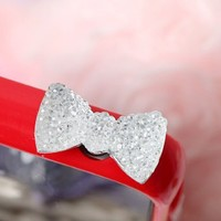 OOOUSE 	 Bow 3.5mm Dustproof Plug Earphone Cover Stopper for iPhone 5 4 iPad Mini Silver