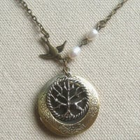Brass locket necklace with pearl and bird tree charm