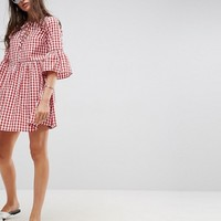 ASOS Lace Up Gingham Smock Dress with Fluted Sleeve at asos.com