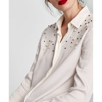 PEARLY SHIRT DETAILS