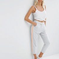 ASOS Cropped Track Pants with Contrast Side Stripe at asos.com
