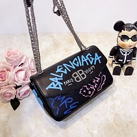 Balenciaga BB ROUND M GRAFFITI Small graffiti print bag with chain strap