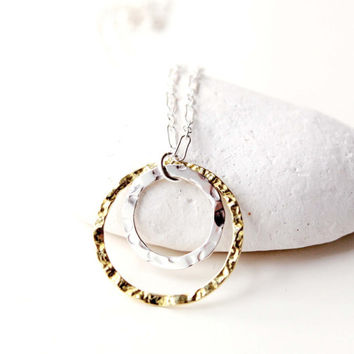 Two circles necklace in mixed metal. Sterling silver and gold vermeil necklace. Modern handcrafted jewelry by EverywhereUR. Minimalist style