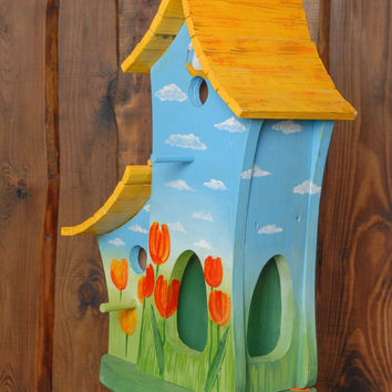 Large wooden birdhouse feeder with painting