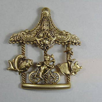 Gold Tone Steam punk Carousel Brooch with Fish, Cupid on Bicycle and Cowboy riding a Pig Vintage Costume Jewelry