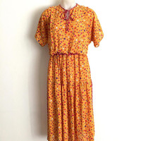 DIANE FREIS!!! Vintage 1980s 'Diane Freis' yellow georgette sundress with multicoloured shell print and shoulder pleats