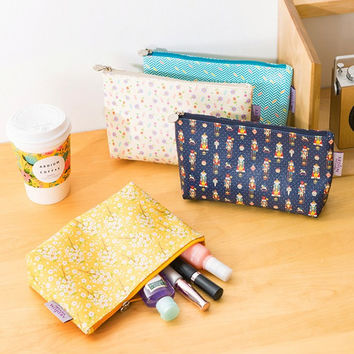 Alpha pattern zipper carry-all pouch