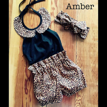 Girls romper and bloomer set with complimentary head wrap. Made in sizes newborn - 5 yrs. black leopard print animal