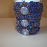 Blue crocheted cup cozy made with vintage buttons