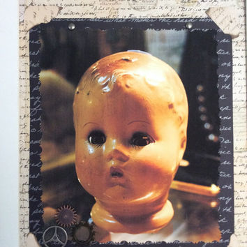 The Creepy Old Baby Doll Framed Collage By Altered Head