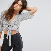 PrettyLittleThing Polkadot Knot Front Blouse at asos.com