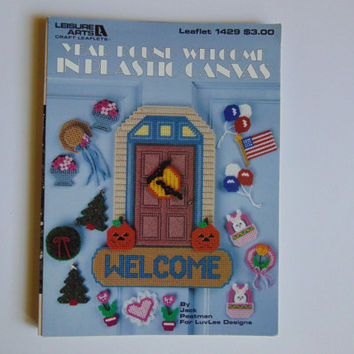 Year Round Welcome in Plastic Canvas Leisure Arts Craft Leaflet # 1429 Paperback – 1992
