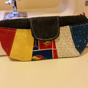 Patchwork clutch made with denim and listened Jayhawk fabric