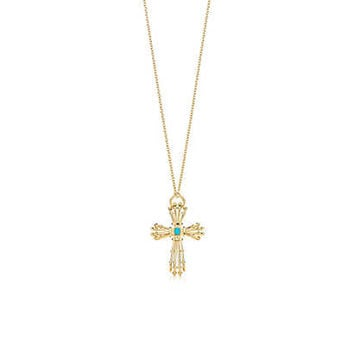 Tiffany & Co. - Jean Schlumberger turquoise wire cross pendant in 18k gold on a chain.