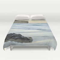 Caressed by the sea water Duvet Cover by Guido Montañés