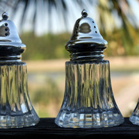 Vintage Boxed Set of Four Glass Salt and Pepper Shakers with Stainless Steel Lids.  Made in Japan.