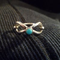 Authentic Navajo Native American Southwestern sterling silver sleeping beauty turquoise infinity loop or ribbon ring.Size 7