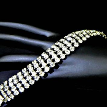 Weiss Clear Rhinestone Four Row Bracelet Curved Signed