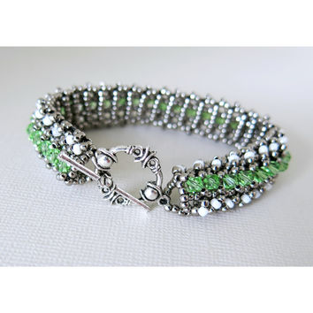 Enchanted - Peridot Swarovski Crystal - Glass Seed Bead Woven Tennis Bracelet - Gunmetal , White Alabaster - Toggle - August Jewelry