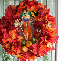 Fall scarecrow wreath with gourds