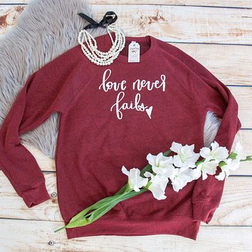 Love Never Fails Premium Fleece Pullover