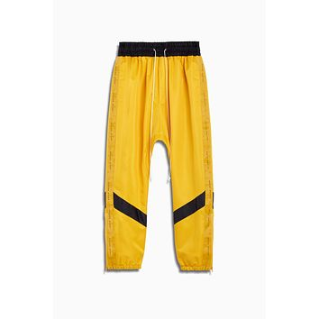 dp parachute track pant ii / yellow + black