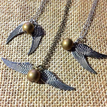 Golden Snitch Necklace inspired by Harry Potter: winged golden sphere necklace, flying gold ball charm