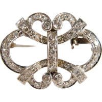 Exceptional French platinum and 2.105ct t.w. diamond brooch with intricate open work design, Ca. 1920s Hallmarked