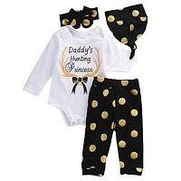 """Baby Girl 4PC Outfit """"Daddy's Hunting Princess"""" White Bodysuit Black and Gold Polka Dot Print Pants Cap and Headband"""