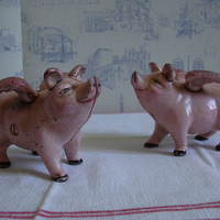 The incredible winged pigs, cast iron piggy banks, antique thriftboxes
