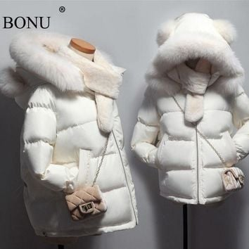 BONU 2017 New Winter Fashion Thicken Big Fur Winter Warm Female Jacket Loosen Slim Coat Hooded Women Hooded Fur Coat dress