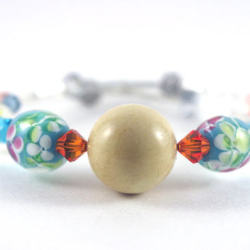 Yellow turquoise memory wire bracelet, Orange blue Swarovski crystal, Blue yellow floral glass bead, Silver plated bead, Memory wrap bangle
