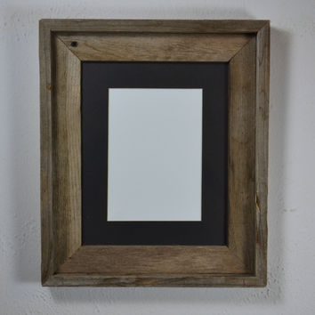 8x10 natural wood frame complete with 5x7 or 8x6 black mat