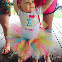 1st birthday mouse bodysuit with name, colorful tutu, and matching hair bow