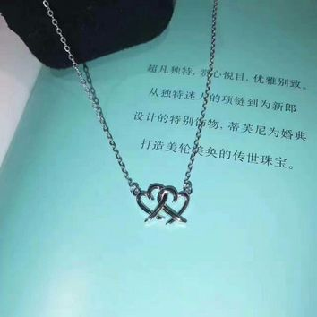 Tiffany & Co. Cross Double Heart Necklace