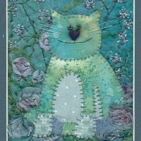 Mixed media embroidery of a cat, hand stitched cat wall art, decorative fabric cat picture