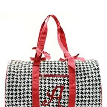 Houndstooth Print with A Quilted Duffel Bag