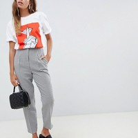 ASOS DESIGN ultimate mono check ankle grazer trousers in dogstooth at asos.com