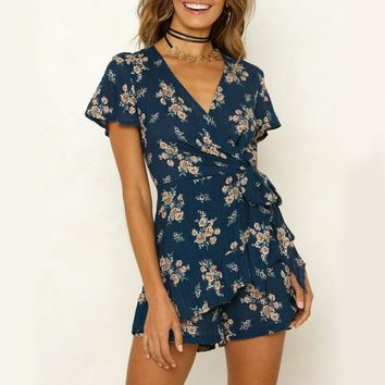 Conmoto Boho Floral Print Rompers Women Sexy V Neck Short Sleeve Bowtie Flower Jumpsuit Ruffle Layered Bohemian Playsuit