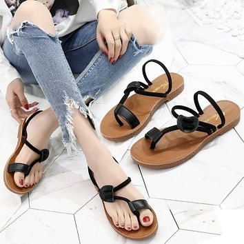 Fashion hot leisure sunflower beach shoes women's shoes tendon sole toe slippers wearing flat sole sandals Black (cowhide band)